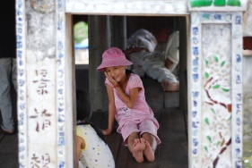 Vietnamese Girl at a Covered Bridge - Version 2